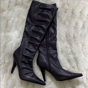 Purple knee high boots with pointed toe